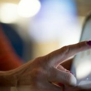 Woman finger computer screen