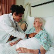 Doctor examines older woman