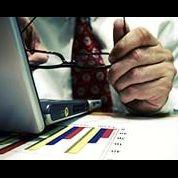Man glasses spreadsheet