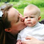Woman kissing baby